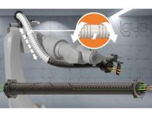 Das neue TRX-System von Igus spart Platz an der dritten Roboterachse und sorgt für eine Rückzugslänge von bis zu 40 Prozent